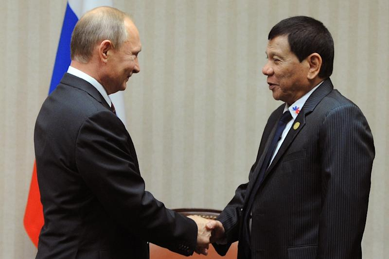 Russian President Vladimir Putin, left, meets his Philippine counterpart Rodrigo Duterte on the sidelines of the APEC summit in 2016