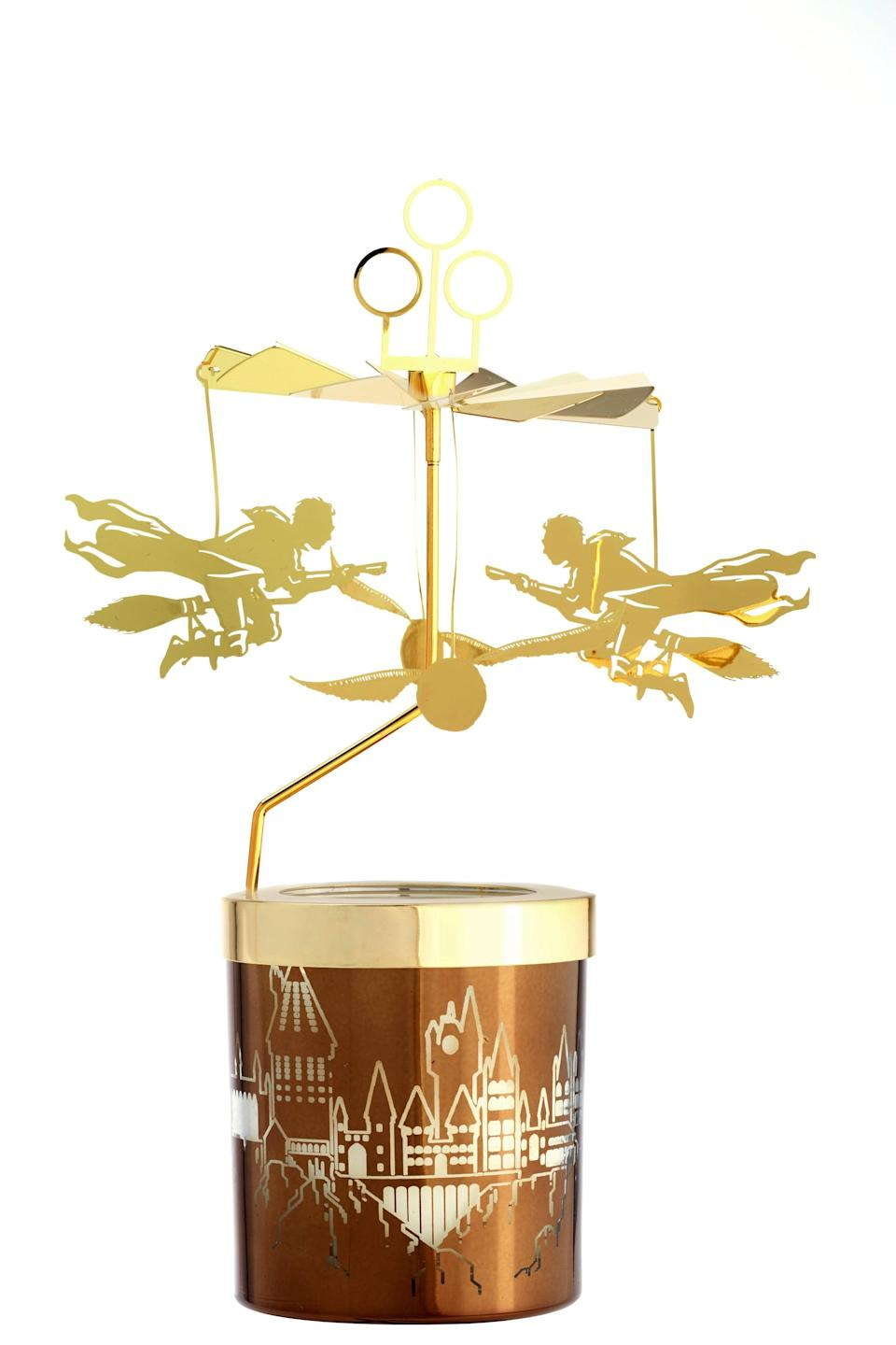"""<p>This whimsical <a rel=""""nofollow noopener"""" href=""""https://www.popsugar.com/buy/Candle-Pot-Carousel-362144?p_name=Candle%20Pot%20Carousel&retailer=potterybarn.com&price=40&evar1=moms%3Aus&evar9=45219298&evar98=https%3A%2F%2Fwww.popsugar.com%2Fmoms%2Fphoto-gallery%2F45219298%2Fimage%2F45219326%2FCandle-Pot-Carousel&list1=home%20decor%2Charry%20potter%2Cpottery%20barn%2Charry%20potter%20home%20decor%2Charry%20potter%20home%2Chome%20shopping&prop13=desktop&pdata=1"""" target=""""_blank"""" data-ylk=""""slk:Candle Pot Carousel"""" class=""""link rapid-noclick-resp"""">Candle Pot Carousel</a> ($40) adds a golden touch to any candle pot top.</p>"""