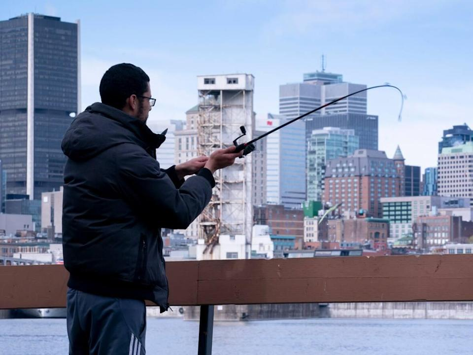 Taher Lamranie, seen here in 2020, is one of countless people who enjoy the St. Lawrence River, but experts say the water is teeming with more than just fish in some places. (Paul Chiasson/The Canadian Press - image credit)