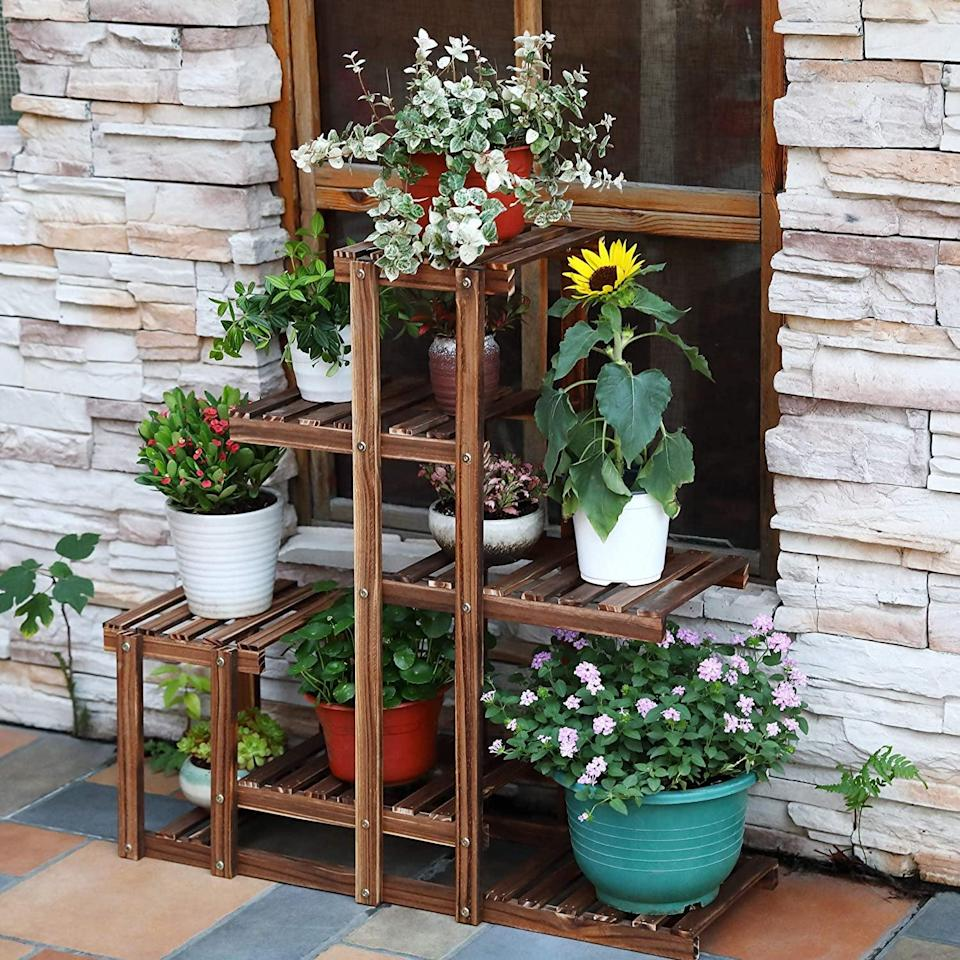 <p>Give your plants a home with this multilevel <span>Hynawin Wood Plant Stand</span> ($25, originally $40).</p>