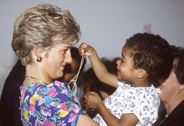 <p>Princess Diana, Princess of Wales, meets a smiling child on a visit to São Paulo, Brazil, on April 24, 1991. (Photo by Tim Graham/Getty Images) </p>