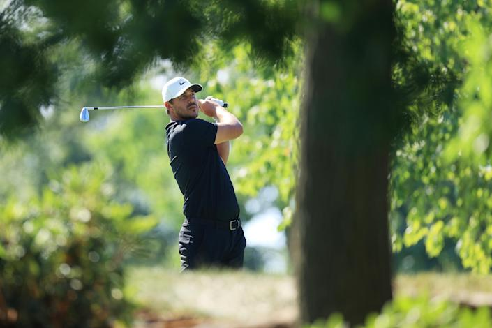 Brooks Koepka plays his shot from the 12th tee during the third round of The Memorial Tournament on July 18, 2020, at Muirfield Village Golf Club in Dublin, Ohio. (Andy Lyons/Getty Images)
