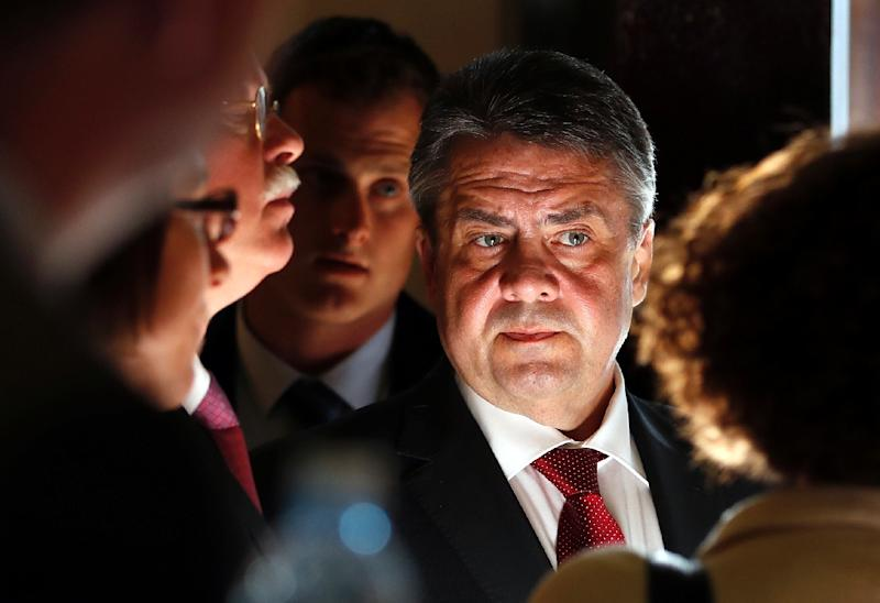 German Foreign Minister Sigmar Gabriel speaks with his staff before giving a press conference in Jerusalem on April 25, 2017 (AFP Photo/THOMAS COEX)