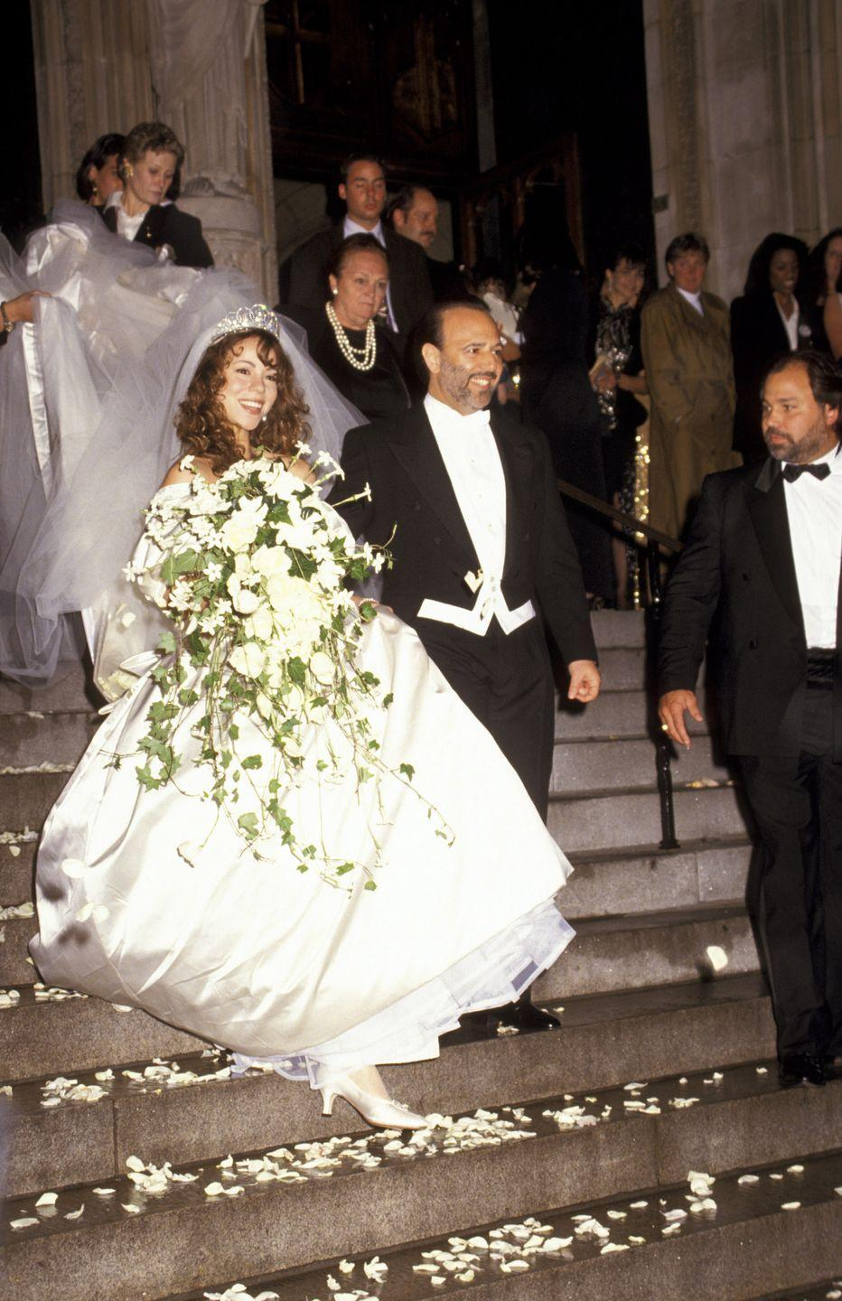 """<p>Mariah Carey married music executive Tommy Mottola on June 5. Carey was 23, and Mottola was 20 years her senior. Carey later described herself to <em><a href=""""https://www.cosmopolitan.com/entertainment/celebs/a28137694/mariah-carey-profile-cover-cosmo-interview-sex-shade-memes/"""" rel=""""nofollow noopener"""" target=""""_blank"""" data-ylk=""""slk:Cosmopolitan"""" class=""""link rapid-noclick-resp"""">Cosmopolitan</a></em> as a """"child bride"""" in that marriage. The couple divorced in 1998.</p>"""