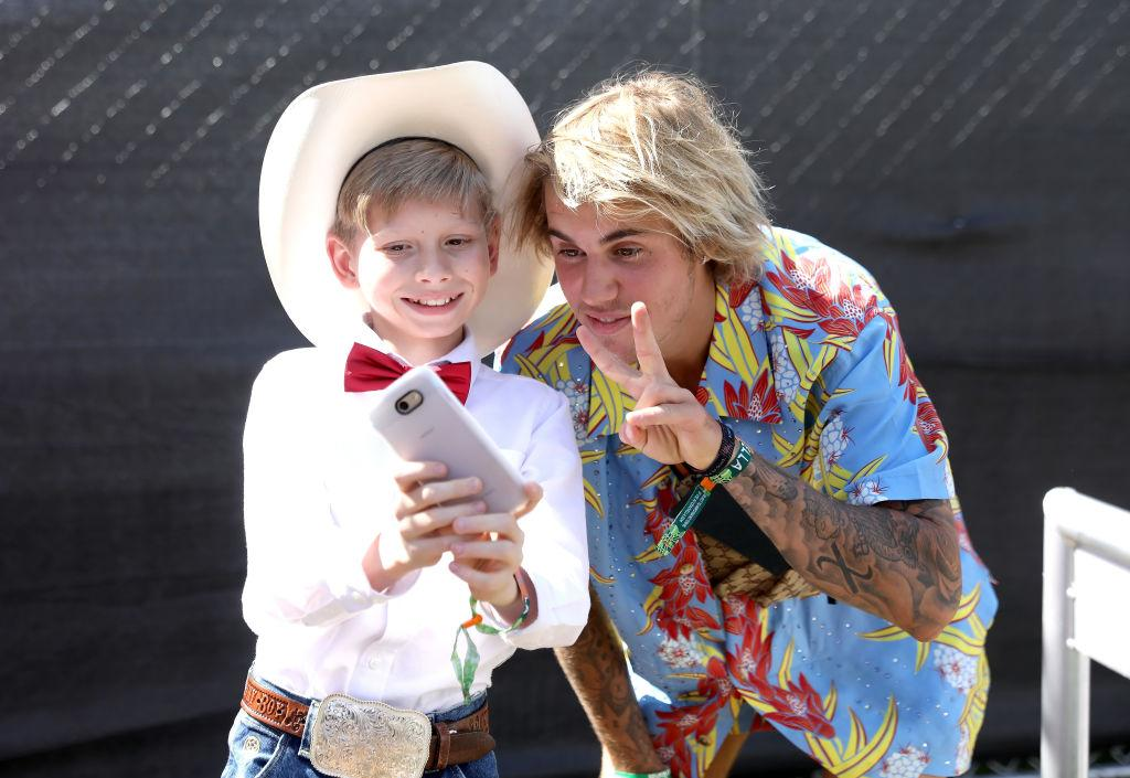 "<p>Internet sensation meet … internet sensation. The Biebs was kind enough to selfie with the Walmart Yodeling Boy, who performed on April 13. Fitting that JB flashed a peace sign because he also <a rel=""nofollow"" href=""https://www.yahoo.com/entertainment/justin-bieber-allegedly-just-punched-190400827.html"">broke up a big fight at the fest</a>, according to reports. A man, who may have been under the influence of drugs, attacked a woman, and Bieber intervened, knocking him out. (Photo: Natt Lim/Getty Images for Coachella) </p>"