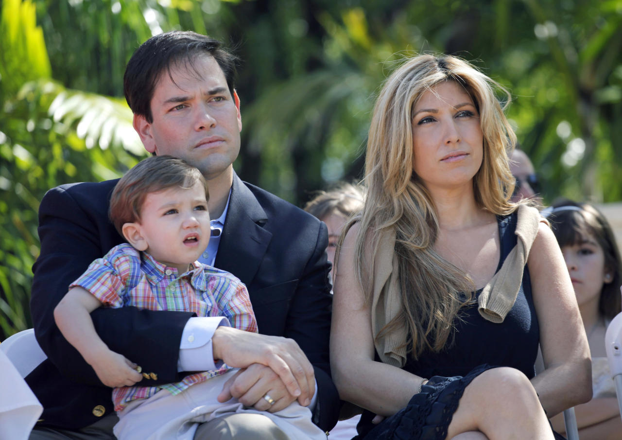U.S. Senate candidate Marco Rubio (R-FL) holds his son Dominick as he sits next to his wife Jeanette (R) during a public event to sign election documents to officially qualify as a Republican party candidate for the U.S. Senate in West Miami, Florida April 27, 2010. Former Vice President Dick Cheney endorsed Republican Marco Rubio in Florida's U.S. Senate race and coupled his announcement with sharp criticism of Rubio's competitor, Governor Charlie Crist. As conservative favorite Rubio picks up momentum before the August 31 primary, support for Crist has been dropping in the Republican Party to the extent that the Florida governor has been contemplating whether to run as an independent.  REUTERS/Carlos Barria