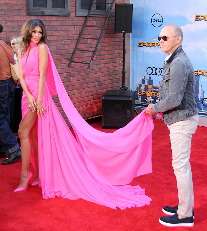 <p>You know you've reached fashion icon status when Michael Keaton holds up your poppin' pink train down the red carpet.</p>