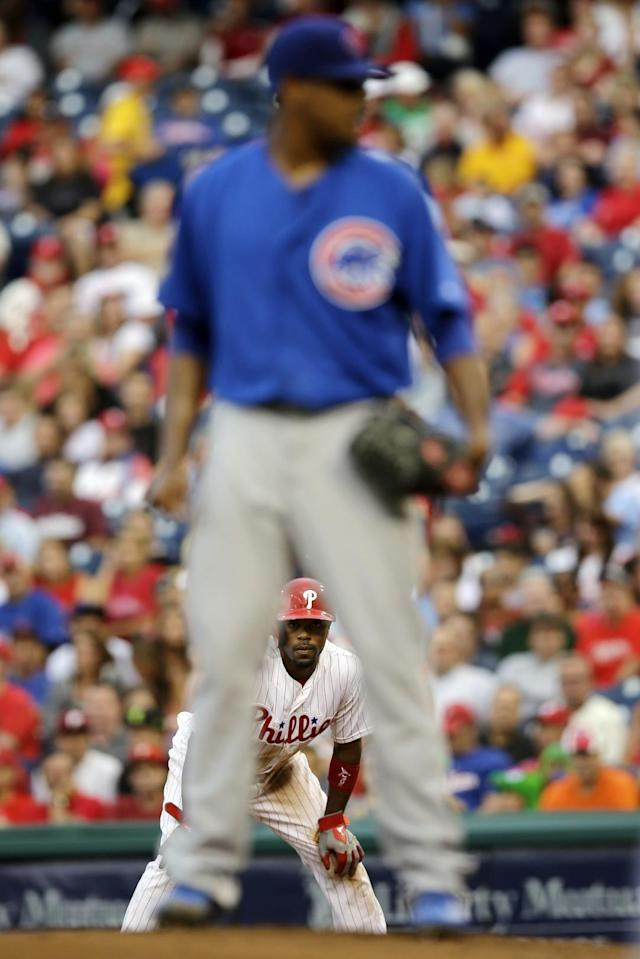 Philadelphia Phillies' Jimmy Rollins, bottom, takes a lead off first base as Chicago Cubs' Edwin Jackson stands on the mound in the first inning of a baseball game, Tuesday, Aug. 6, 2013, in Philadelphia. (AP Photo/Matt Slocum)