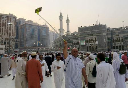 A Muslim pilgrim takes selfie at the Grand mosque in Mecca
