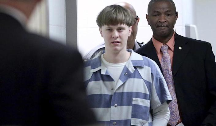 Dylann Roof enters the court room at the Charleston County Judicial Center in 2017 to enter his guilty plea on murder charges in Charleston, S.C. (Grace Beahm/The Post And Courier via AP, Pool, File)