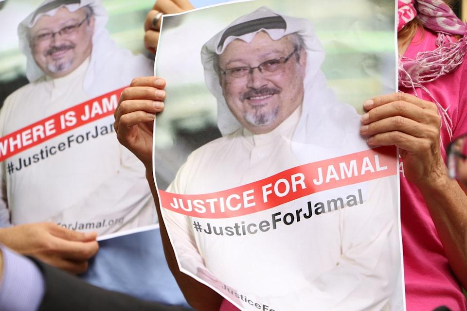 WASHINGTON, USA - OCTOBER 10: A member of the Organization 'Justice for Jamal Khashoggi' holds a picture of Khashoggi as she and other members hold news conference for disappearance of Saudi journalist in front of The Washington Post headquarters in Washington D.C. with the attendance of Congressman Gerry Connolly and figures from CAIR and Pen America spoke, in Washington D.C., United States on October 10, 2018. (Photo by Umar Farooq/Anadolu Agency/Getty Images)