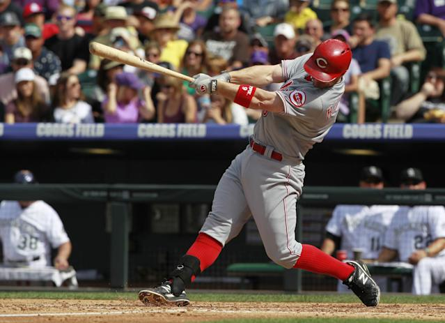 Cincinnati Reds' Jack Hannahan singles against the Colorado Rockies in the fourth inning of a baseball game in Denver, Sunday, Sept. 1, 2013. (AP Photo/David Zalubowski)