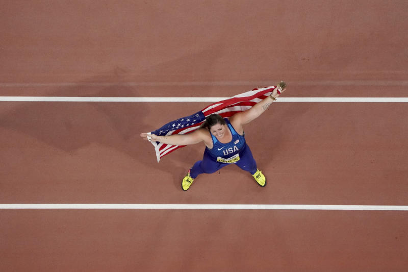 Deanna Price, of the United States, celebrates winning the gold medal for the women's hammer throw at the World Athletics Championships in Doha, Qatar, Saturday, Sept. 28, 2019. (AP Photo/Morry Gash)