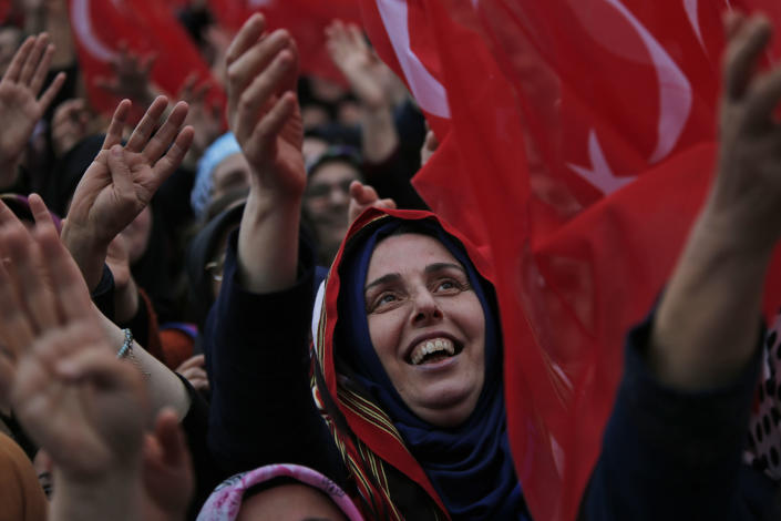 Supporters of Turkey's President Recep Tayyip Erdogan cheers as he arrives at a rally of his ruling Justice and Development Party's (AKP), in Istanbul, Friday, March 29, 2019, ahead of local elections scheduled for March 31, 2019. Erdogan has been holding multiple daily rallies across the country, using highly polarising language, portraying the opposition as traitors who are supported by terrorists. (AP Photo/Lefteris Pitarakis)