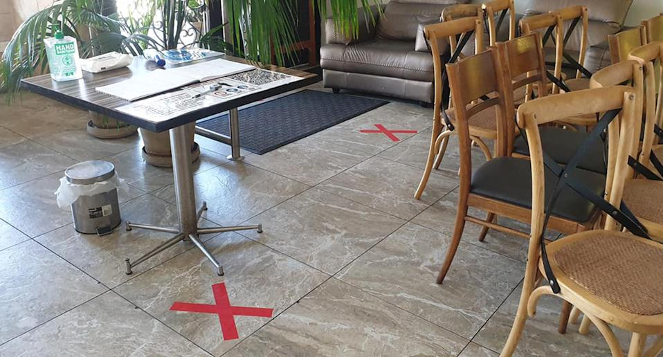 Social distancing markers appear on the floor of Jasmins1 Lebanese restaurant in Liverpool
