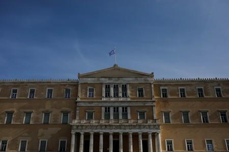 Greece approves cut on property tax, eases arrears repayment