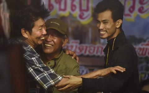 <span>Family members celebrate while camping out near Than Luang cave&nbsp;</span> <span>Credit: AFP </span>