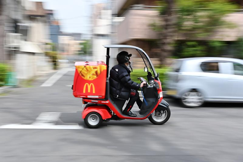 A man working for McDonald's delivery service rides a motorcycle in Tokyo's Taito district on March 26, 2019. (Photo by CHARLY TRIBALLEAU / AFP) (Photo credit should read CHARLY TRIBALLEAU/AFP/Getty Images)