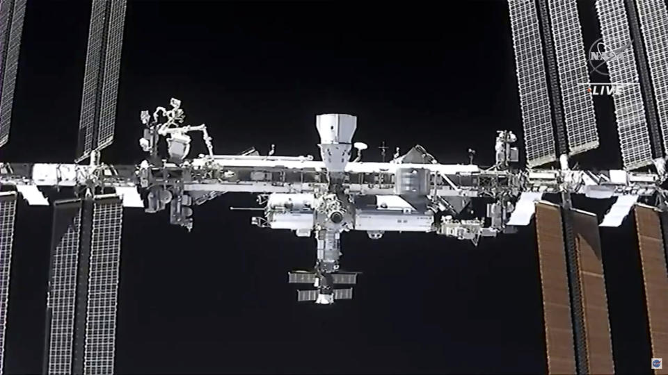 This image made from NASA TV shows the international space station, seen from the SpaceX Crew Dragon spacecraft Saturday, April 24, 2021. The recycled SpaceX capsule carrying four astronauts has arrived at the International Space Station, a day after launching from Florida. (NASA via AP)