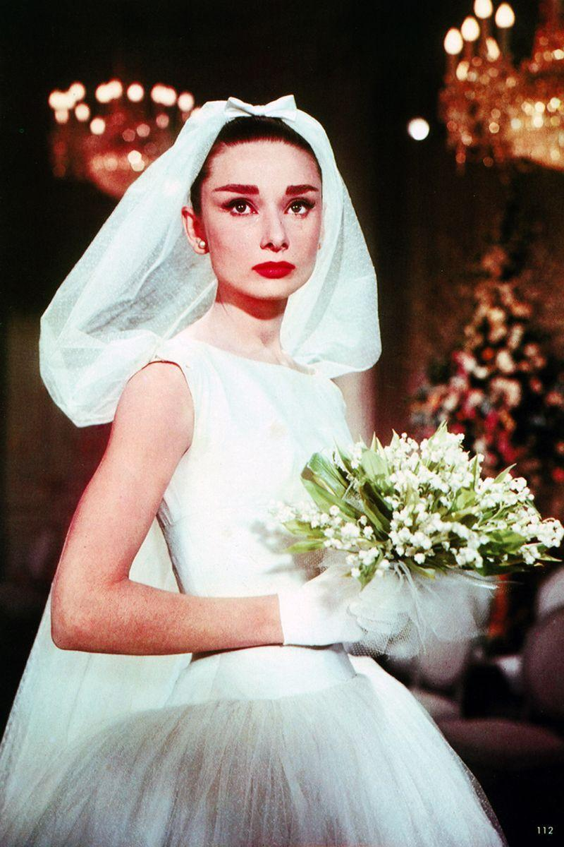 "<p>Although Jo Stockton (Audrey Hepburn) was a heartbroken model when she first put on the <a href=""https://www.theweddingsecret.co.uk/magazine/iconic-wedding-dresses-from-the-movies-funny-face/#:~:text=This%20classic%20'50s%2Dstyle%20gown,know%20and%20love%20Audrey%20for."" rel=""nofollow noopener"" target=""_blank"" data-ylk=""slk:Hubert de Givenchy short tulle wedding dress"" class=""link rapid-noclick-resp"">Hubert de Givenchy short tulle wedding dress</a> in <em>Funny Face</em><em>,</em> by the end she was floating off with her desired in a truly iconic scene.<br></p>"