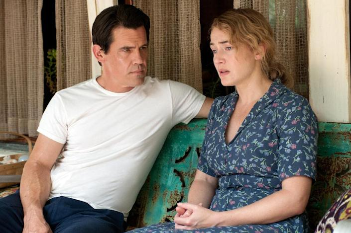 """This image released by Paramount Pictures shows Josh Brolin, left, and Kate Winslet in a scene from """"Labor Day."""" (AP Photo/Paramount Pictures, Dale Robinette)"""