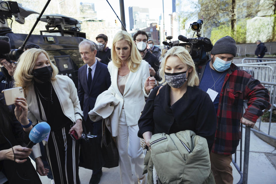 Accuser Danielle Bensky, at right, departs following Ghislaine Maxwell's appearance in Federal Court on Friday, April 23, 2021, in New York. Ghislaine Maxwell, a British socialite and one-time girlfriend of Epstein, pleaded not guilty to sex trafficking conspiracy and an additional sex trafficking charge that were added in a rewritten indictment released last month by a Manhattan federal court grand jury. (AP Photo/Kevin Hagen)