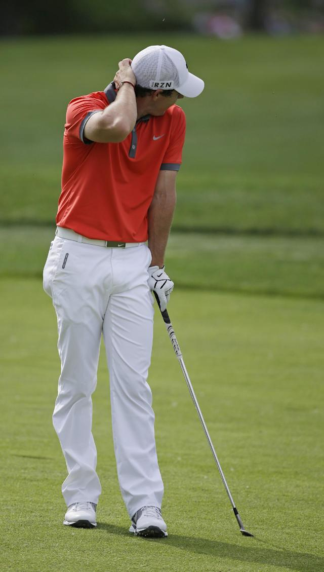 Rory McIlroy, of Northern Ireland, reacts to his shot from the 13th fairway during the first round of the Memorial golf tournament Thursday, May 29, 2014, in Dublin, Ohio. (AP Photo/Darron Cummings)