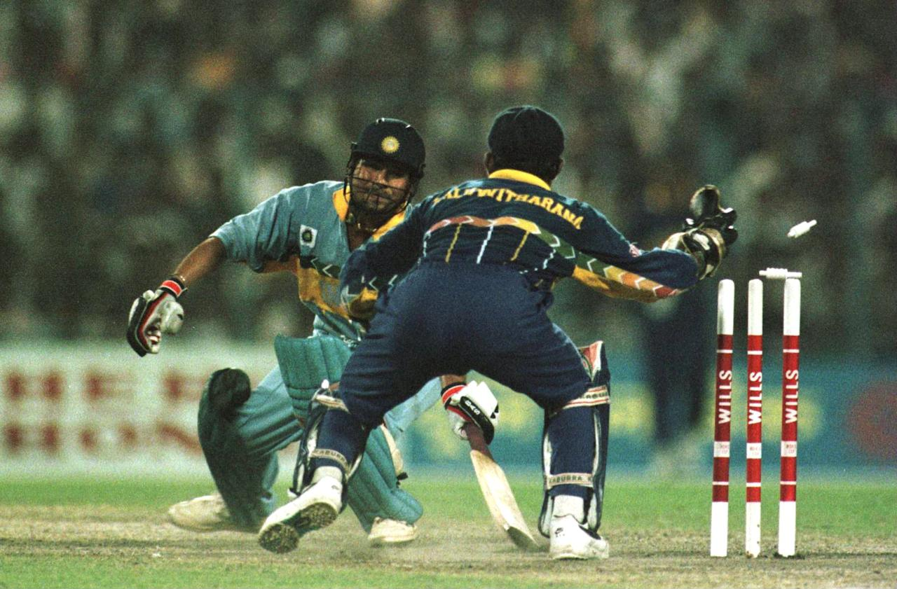 13 Mar 1996: Sachin Tendulkar of India is stumped by Kaluwitharana of Sri Lanka for 65 during the semi-final in the Cricket World Cup between India and Sri Lanka played at Eden Gardens in Calcutta, India. Mandatory Credit: Ross Kinnaird/ALLSPORT
