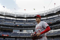 Los Angeles Angels pitcher Shohei Ohtani walks onto the field to warm up before his start against the New York Yankees in a baseball game Wednesday, June 30, 2021, in New York. (AP Photo/Adam Hunger)