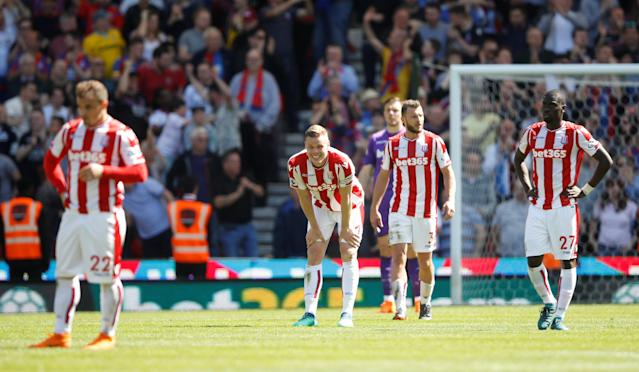 "Soccer Football – Premier League – Stoke City vs Crystal Palace – bet365 Stadium, Stoke-on-Trent, Britain – May 5, 2018 Stoke City's <a class=""link rapid-noclick-resp"" href=""/soccer/players/ryan-shawcross/"" data-ylk=""slk:Ryan Shawcross"">Ryan Shawcross</a> and team mates react after conceding their second goal scored by Crystal Palace's Patrick van Aanholt Action Images via Reuters/Carl Recine"