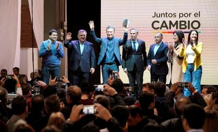 Argentina's President Mauricio Macri, who is running for reelection, and his running mate Miguel Angel Pichetto share the stage with others, in Cordoba