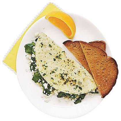 """<p>This easy and healthy omelet cuts fat and calories by using only egg whites, but adds delicious flavor with plenty of herbs and <a href=""""https://www.myrecipes.com/t/cheese/feta"""" rel=""""nofollow noopener"""" target=""""_blank"""" data-ylk=""""slk:crumbled feta"""" class=""""link rapid-noclick-resp"""">crumbled feta</a>, plus nutrient-rich chopped spinach. </p>"""