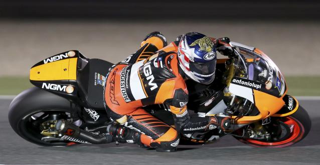 NGM Mobile Forward Racing MotoGP rider Colin Edwards of the U.S. races during a free practice session at the MotoGP World Championship at the Losail International circuit in Doha March 21, 2014. REUTERS/Fadi Al-Assaad (QATAR - Tags: SPORT MOTORSPORT)