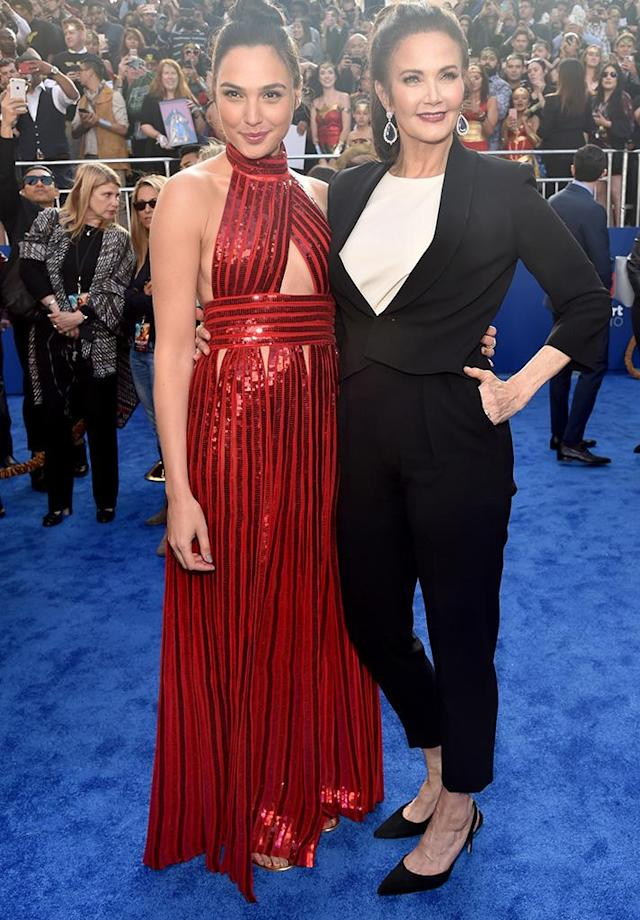 <p>Wonder women! Gal Gadot — star of the new <em>Wonder Woman</em> movie — shared a moment with the original Wonder Woman, Lynda Carter, at the Hollywood premiere of the superhero flick. Gadot dazzled in a red Givenchy gown, while Carter looked sharp in a black pantsuit. Can you believe she is 65?! (Photo: Alberto E. Rodriguez/Getty Images) </p>