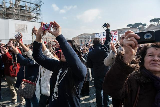 VATICAN CITY, VATICAN - FEBRUARY 17: Faithful attend Pope Benedict XVI Angelus Blessing at St. Peter's Square on February 17, 2013 in Vatican City, Vatican. The Pontiff will hold his last weekly public audience on February 27 at St Peter's Square after announcing his resignation last week. (Photo by Giorgio Cosulich/Getty Images)