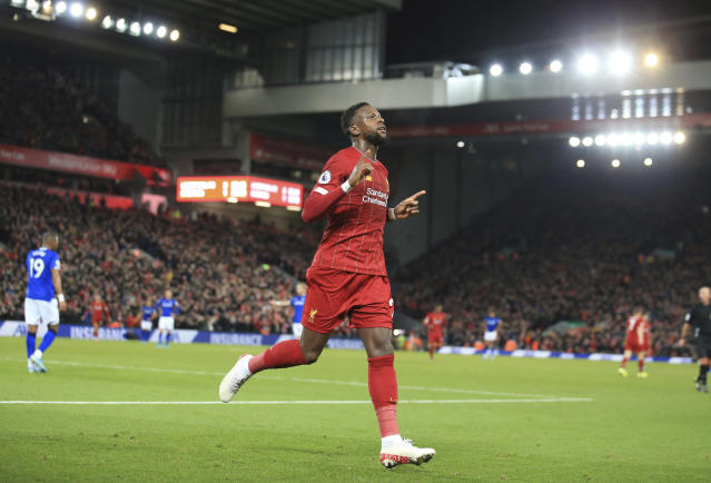 Liverpool's Divock Origi celebrates his second goal against Everton during the English Premier League soccer match between Liverpool and Everton at Anfield Stadium, Liverpool, England, Wednesday, Dec. 4, 2019. (AP Photo/Jon Super)