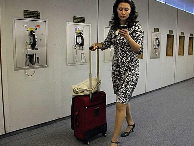 business woman at airport on phone