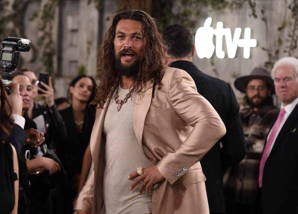 "Jason Momoa, a cast member in the Apple TV+ series ""See,"" arrives at the premiere at the Regency Village Theatre, Monday, Oct. 21, 2019, in Los Angeles. (Photo by Chris Pizzello/Invision/AP)"