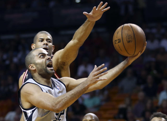 FILE - In this Jan. 26, 2014, file photo, Miami Heat's Shane Battier (31) tries to block San Antonio Spurs' Tony Parker (9) during the first half of a NBA basketball game in Miami. Though he's 31 years old, Parker still gets from point A to point B faster than most. And unlike some of the other top point guards, Parker has been durable, missing just four games. (AP Photo/J Pat Carter, File)