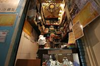 Kazem Mabhutian, 63, serves tea at the smallest and oldest teahouse tucked in an alleyway of the Grand Bazaar in the Iranian capital Tehran (AFP/ATTA KENARE)