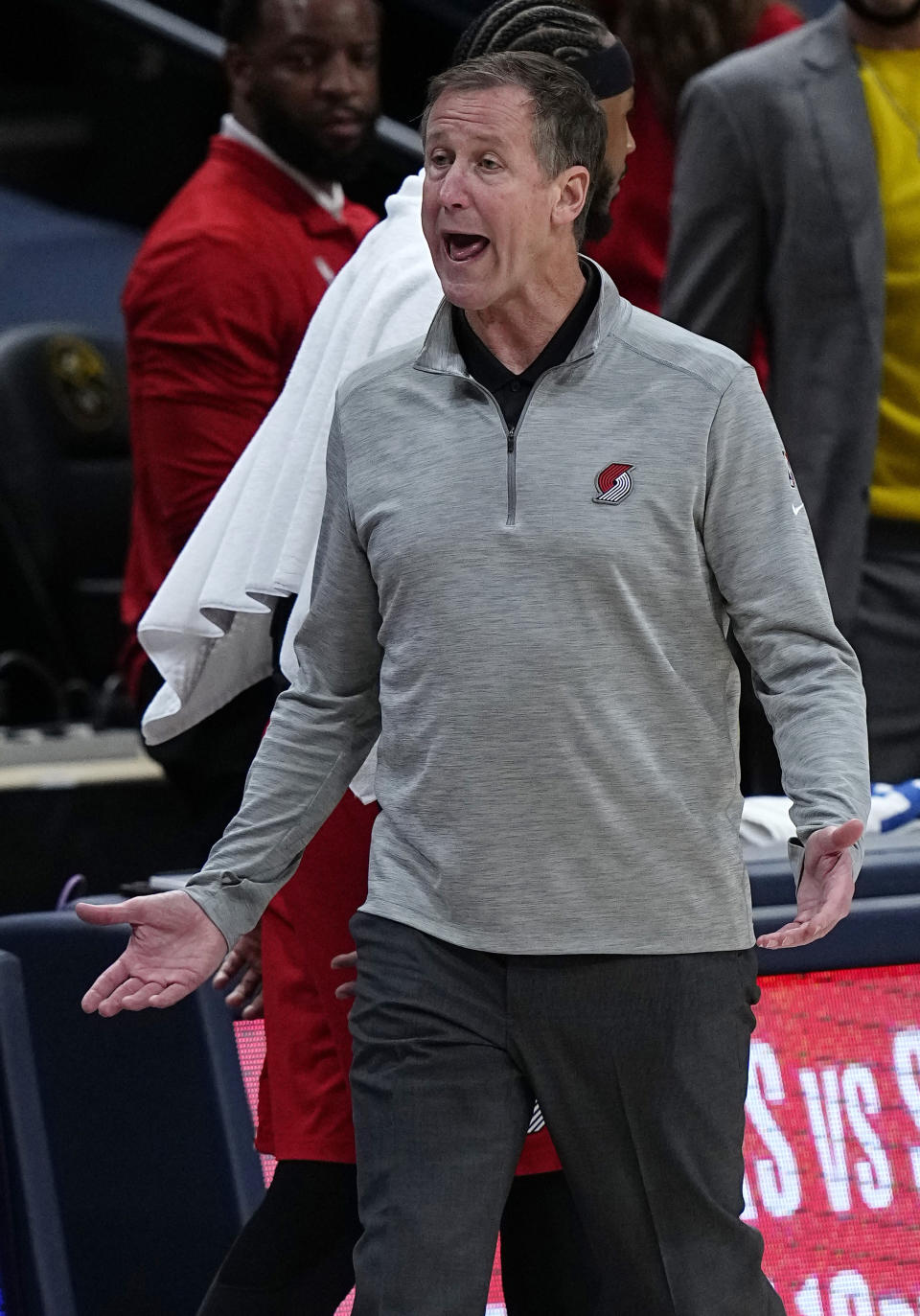 Portland Trail Blazers head coach Terry Stotts reacts to a missed call against the Denver Nuggets in the first half of Game 5 of a first-round NBA basketball playoff series Tuesday, June 1, 2021, in Denver. (AP Photo/Jack Dempsey)