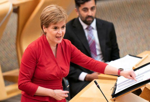 <strong>Nicola Sturgeon speaks at the Scottish parliament during First Minister's Questions.</strong> (Photo: JANE BARLOW via Getty Images)