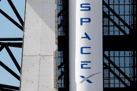 FILE PHOTO: A SpaceX Falcon 9 carrying the Crew Dragon spacecraft sits on launch pad 39A prior to the uncrewed test flight to the International Space Station from the Kennedy Space Center in Cape Canaveral