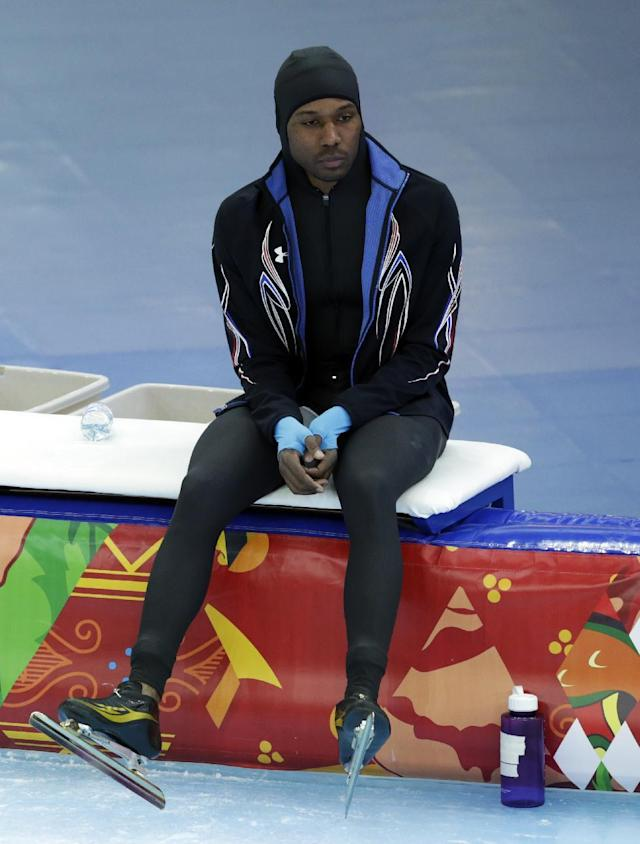 Shani Davis of the U.S. looks dejected after competing in the men's 1,500-meter speedskating race at the Adler Arena Skating Center during the 2014 Winter Olympics in in Sochi, Russia, Saturday, Feb. 15, 2014. (AP Photo/Matt Dunham)