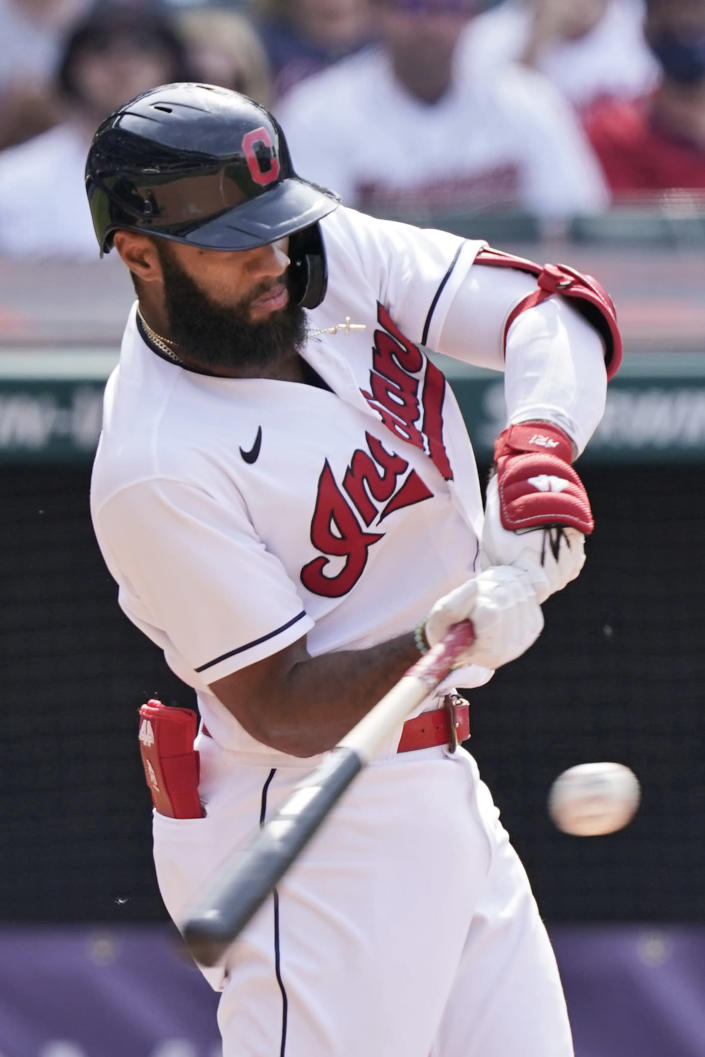 Cleveland Indians' Amed Rosario hits a single in the ninth inning of a baseball game against the Minnesota Twins, Sunday, May 23, 2021, in Cleveland. (AP Photo/Tony Dejak)