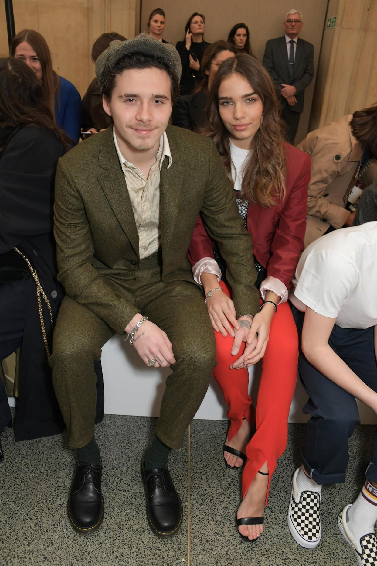 Brooklyn Beckham brought along his girlfriend Hana Cross to the family event [Photo: Getty]