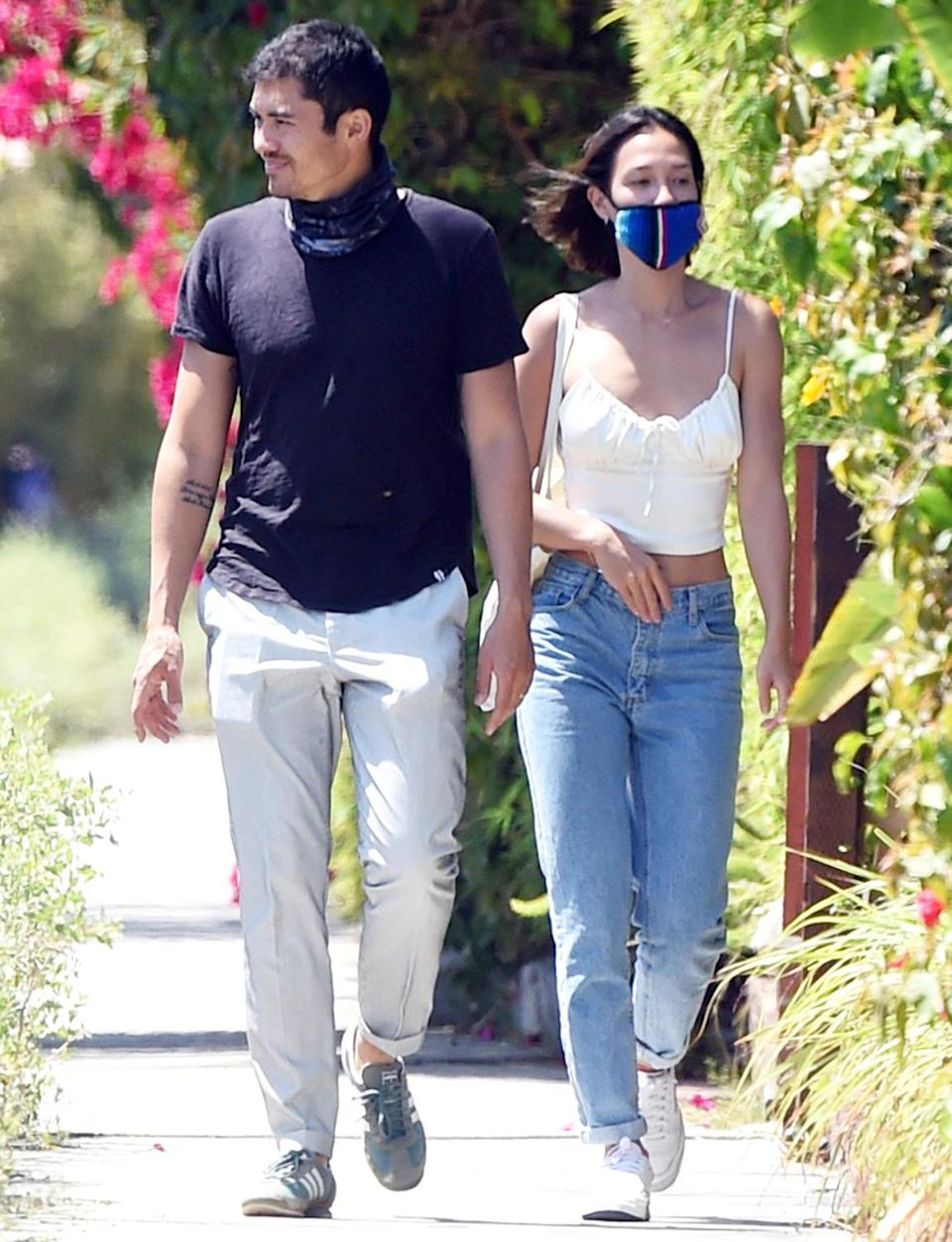 <p>Henry Golding and wife Liv Lo get some exercise in their Los Angeles neighborhood on Tuesday.</p>