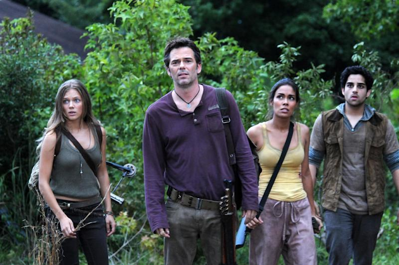 "FILE - This file image released by NBC shows, from left, Tracy Spiridakos as Charlie Matheson, Billy Burke as Miles Matheson, Daniella Alonso as Nora, and Paras Patel as Albert, in a scene from ""Revolution."" Violent dramas on the broadcast networks carry milder parental cautions than cable shows but can equal them in graphic gore, a failure of the TV ratings system, according to a Parents Television Council study released Monday, Dec. 9, 2013. (AP Photo/NBC, Brownie Harris, File)"