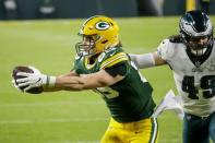 Green Bay Packers' Robert Tonyan catches a touchdown pass in front of Philadelphia Eagles' Alex Singleton during the first half of an NFL football game Sunday, Dec. 6, 2020, in Green Bay, Wis. (AP Photo/Mike Roemer)