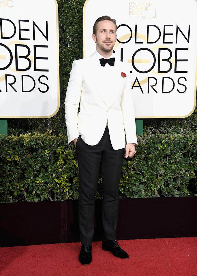 <p>Ryan Gosling looked dashing in a white-and-black custom Gucci Signoria tuxedo at the 74th Annual Golden Globe Awards. (Photo: Getty Images) </p>